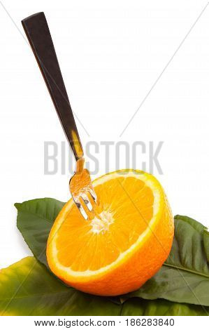 Cut orange with a plug on leaves isolated on a white background