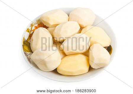 Pile of peeled potatoes on a plate isolated on the white background
