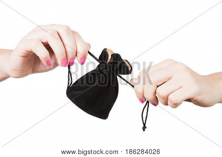 Woman hands hold a little black bag for jewelry close up isolated on a white background
