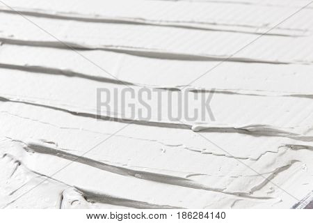 Relief structure white background, closeup of plaster texture, rough daub. Backdrop with free space for text.