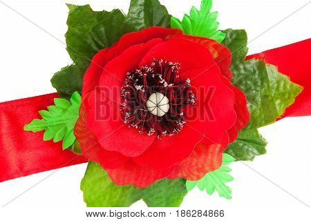 Red tape with a poppy from a fabric