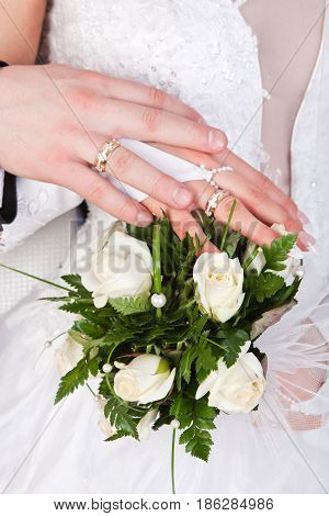 Hands Of Bride And Grom With Rings And Wedding Bouquet