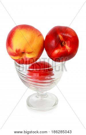 Ripe fresh tasty appetizing nectarine in a glass bowl