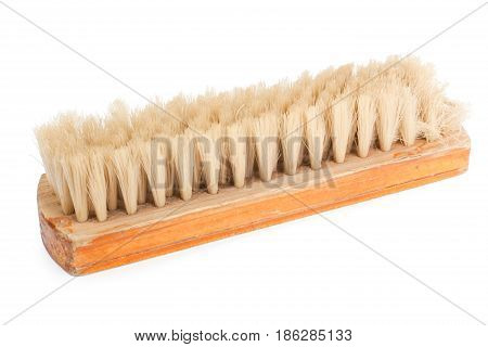 Brown wooden brush isolated on white background.