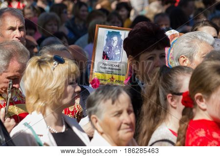 MARGANETS UKRAINE - MAY 9 2017: Townspeople of Marganets carry portraits of their heroic relatives that participated in the Second World War on meeting dedicated to celebrating Victory over Nazism