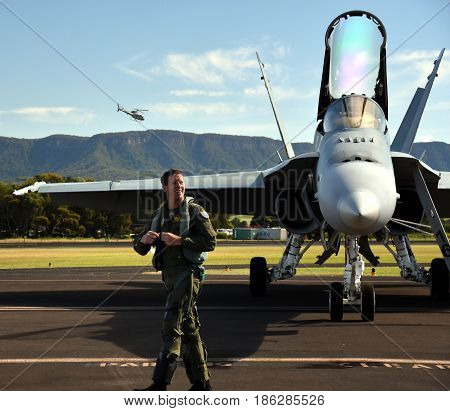 Albion Park Australia - May 6 2017. RAAF F/A-18 Hornets and the pilot. Wings Over Illawarra is an annual air show held at Illawarra Regional Airport.