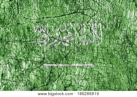 Grudge stone painted Saudi Arabia flag and written arab word shahada which means There is no god but ALLAH