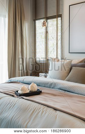King Bed Size With Set Of Pillws And Set Of Tea On Tray In Classic Bedroom Style