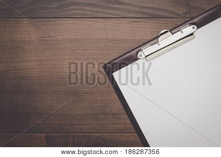 top view of notepad. brown office table with notepad. notepad on the desk. notepad on wooden background
