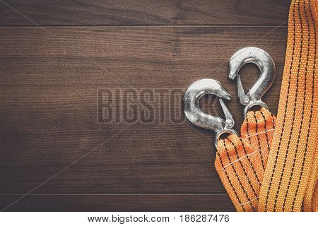 orange towing rope on the wooden table