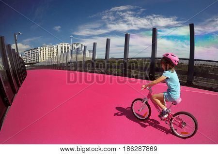 Young Girl Ride A Bike