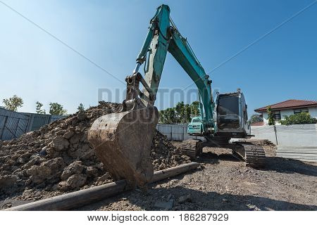 Excavator On Construction Site, Digger On Gravel Heap With Shovel