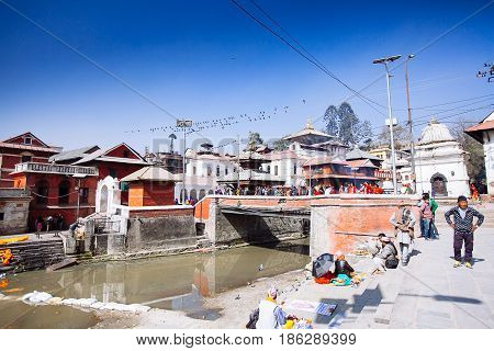 Kathmandu, Nepal-february 7, 2017: Hindu Ritual Of Cremation In The Pashupatinath Temple.