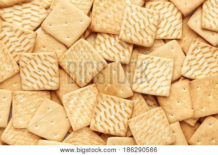 A lot of cracker scattered background sweet flour product space for text
