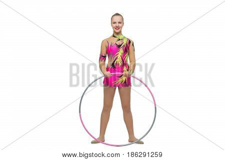 beautiful blond teen age gymnast girl making exercises with hula hoop. Studio shot isolated on white background. Copy space.