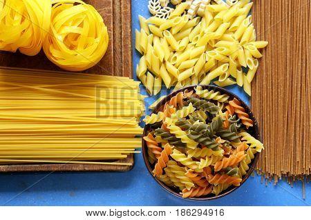 Various types of pasta (spaghetti, penne, fusilli)
