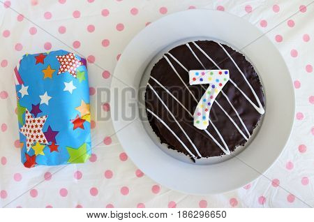 Present And Chocolate Birthday Cake For A Seventh Birthday Or Anniversary Celebration