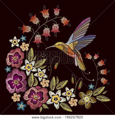 Humming bird and beautiful flowers embroidery on black background. Elegant flowers and tropical humming bird vector. Decorative floral embroidery. Template for sewing clothing textiles