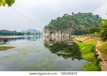 Scenic mountain park featuring waterfalls caves an ancient tomb a Buddhist pagoda & sculptures