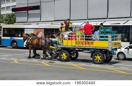 LUCERNE, SWITZERLAND - JUNE 12, 2013: horse beer cart on Lucerne street. Switzerland