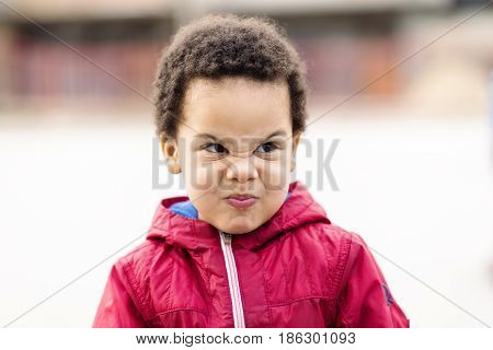 portrait of a beautiful multi racial boy making silly face