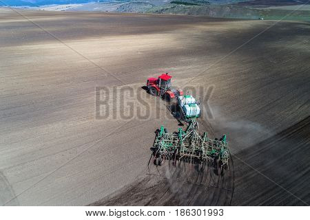 tractor sowing in the field. earial view.