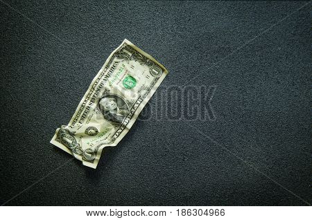 One dollar crumpled bill. Selective focus