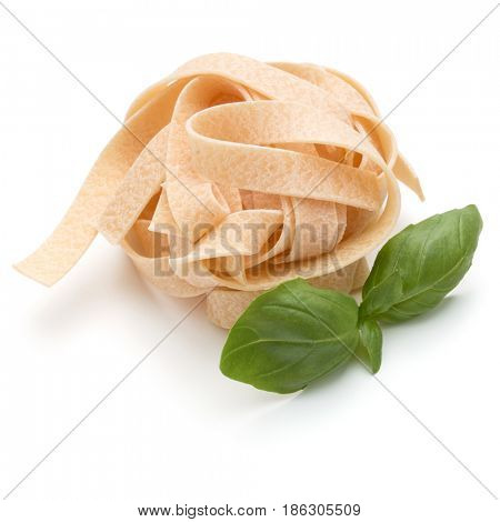 Italian pasta fettuccine nest and basil leaves  isolated on white background cutout