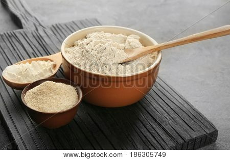 Composition with flour on grey textured table