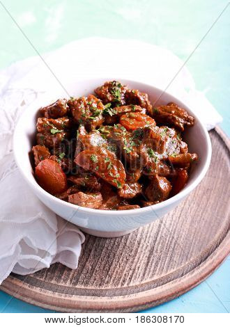 Beef stew with carrot - goulash in a bowl