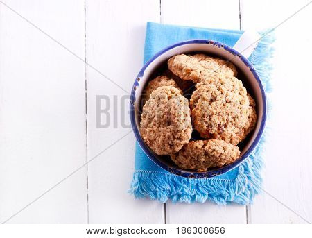 Oat and raisin biscuits in a mug top view