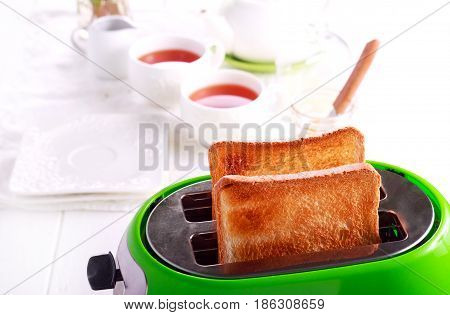 Toasts in a toaster kitchen interior background