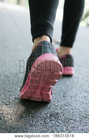 Female Sport Fitness Runner Jogging Outdoors In Spring Or Summer. Healthy Young Asian Woman Running