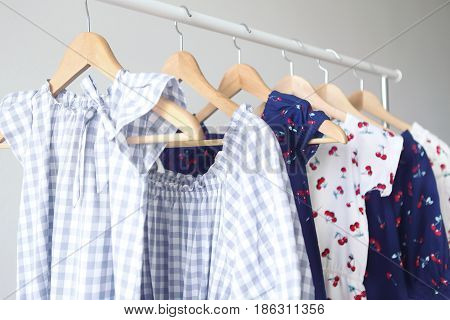 Variety of casual dresses on hangers. Close up