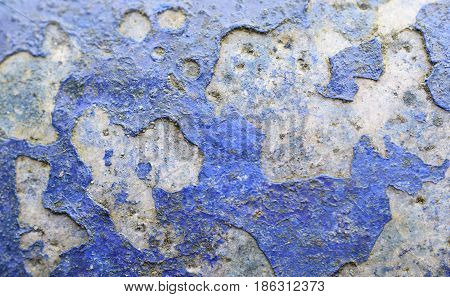 Old blue paint exposed to the elements
