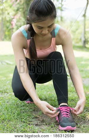 Urban Athlete Woman Tying Running Shoe Laces. Female Sport Fitness Runner Getting Ready For Jogging