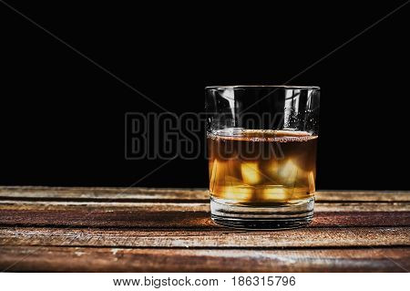 Whiskey On Wooden Surface