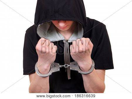 Young Man in Handcuffs on the White Background