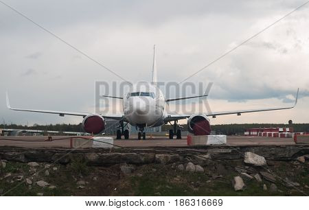 The Plane On The Background Of The Cloudy Sky And Forest,