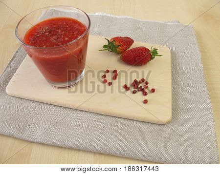 Strawberry smoothie with pink peppercorn in glass