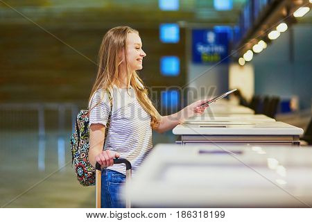 Traveler With Backpack In International Airport At Check-in Counter