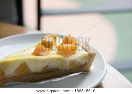 A Piece Of Cheese Cake Tart With Fresh Mango, Delicious Mango Tart