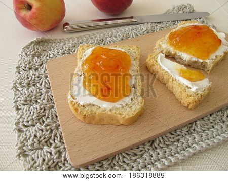 Twice baked bread with cream cheese and peach jam
