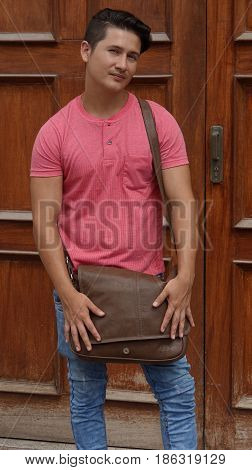 A Man Or Student With Leather Satchel