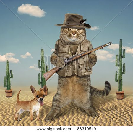 The cat hunter is holding a real gun. His dog is next to him.
