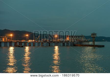 Evening Sukhum view of the boat station lit with burning lanterns