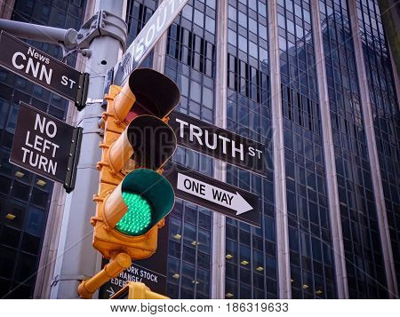 NYC Wall street yellow traffic green light black pointer guide One way to truth. No way no turn to CNN fake news. Right Choice is truth. Mass media news concept. Politics