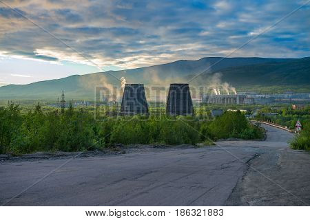 Beautiful and wild tundra of the Arctic in Russia and industrial plant. Works throw their waste into the atmosphere. The beauty of these places could be lost forever. Take care of nature!