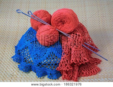 colored yarn for knitting with spokes on a yellow mats. macro still life