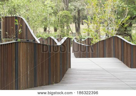 Wooden Bridge With Handrail In The Park